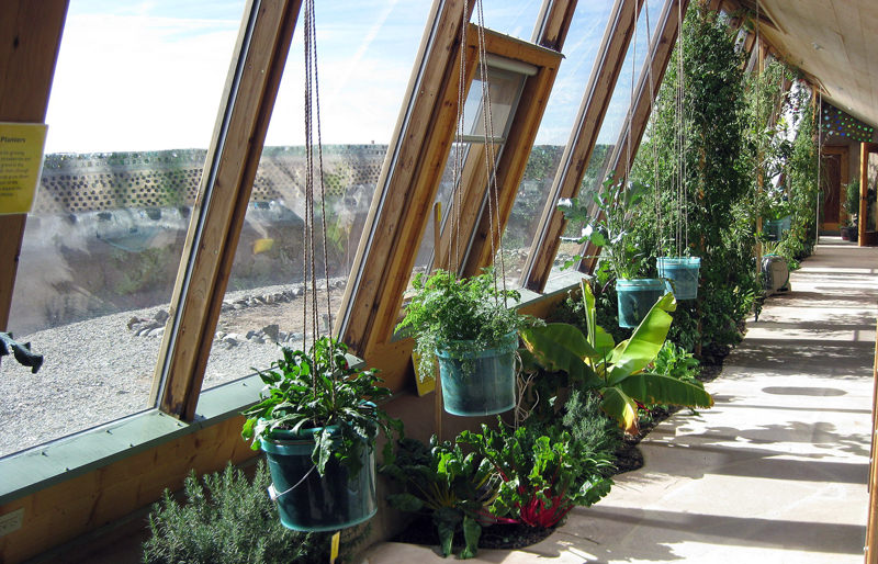Earthship inside greenhouse